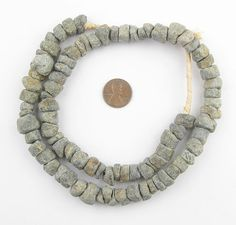 Mali Stone beads are said to be centuries old because they seem to have been made in a very primitive way. This strand of African beads is 24 long