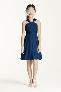 Youthful and fun, this crinkle chiffon and charmeuse short dress is perfect for the Junior Bridesmaid. Y-neckline gives this dress a modern twist and adds interest. Soft chiffon drapes beautifully into a bubble hem, while the charmeuse adds a touch of shine to the look. Coordinates beautifully with any of our chiffon or charmeuse bridesmaid dresses. This style features an adjustable fit for added flexibility and comfort with fewer alterations. Fully lined. Back zip. Imported