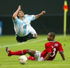 Ariel Ortega goes flying over a challenge from Ashley Cole at the 2002 World Cup in Japan.