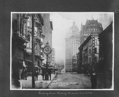 "Looking down Kearny towards Market St (1906) Caption on print: ""Call Building on fire, April 18, 1906 