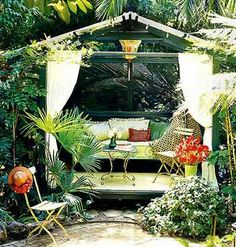 Dream Escape  This 6- x 13-foot screened pavilion occupies a wooden platform near a small pond. Gauzy curtains frame the entrance and provide privacy and bug protection when needed.