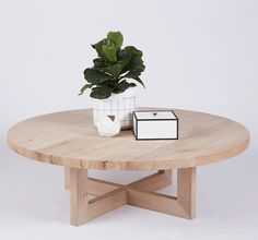 The Bondi Round Elm Wooden and Timber Coffee Table. Sitting on top is a By Lassen Frame Storage Box and fiddle leaf fig tree in a Ferm Living small Grid Basket. All available in our online store.