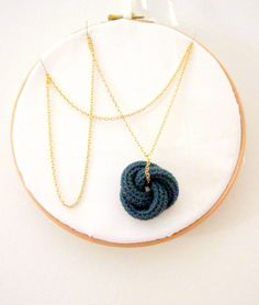 Etarnally. Crochet knot pendant in cypress green. $12.00, via Etsy.