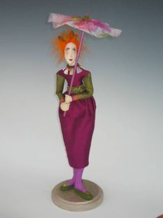"""This graceful 18"""" figure carries a beautiful parasol to keep the color in her hair and off her skin."""