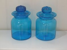 Vintage Set of 2 Turquoise or Bright Blue Glass Blown Canisters, apothecary jars, storage containers or candy dish- vintage glass. $38.00, via Etsy.