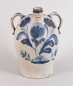 Impressive John Bell stoneware harvest jug with extensive cobalt floral decoration and applied loop handles, the neck stamped John Bell, the reverse inscribed Waynesboro PA May 12th 1860 within a scrolling cartouche, the base inscribed in script Waynesboro PA May 12th 1860 JW Bell, 17 3/4'' h. This is one of the most important pieces of Bell stoneware to come on the market in recent years.