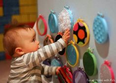 Fun sensory play idea made with fabric scraps and embroidery hoops.