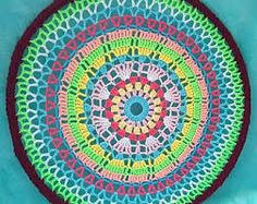 Image result for wheelchair wheel covers made from crochet Wheel Cover, Beach Mat, Outdoor Blanket, Chair, Crochet, Image, Products, Ganchillo, Stool