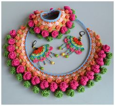 Statement necklace crochet using my own pattern. Various colors of cotton and cotton-viscose mix. Mounted on a silicone cable base, interior
