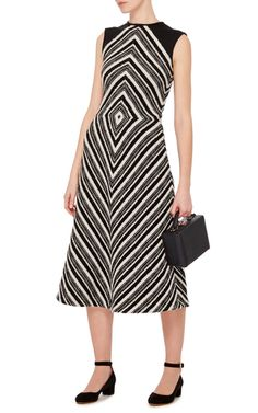 This **Martin Grant** dress features an a-line silhouette with a rounded neckline.
