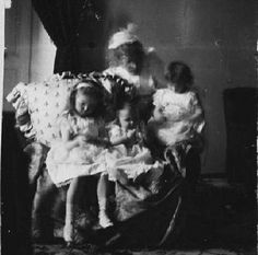 Grand Duchesses Olga and Tatiana and their baby sister Maria with their great-grandmother, the Queen of Denmark, in 1899.