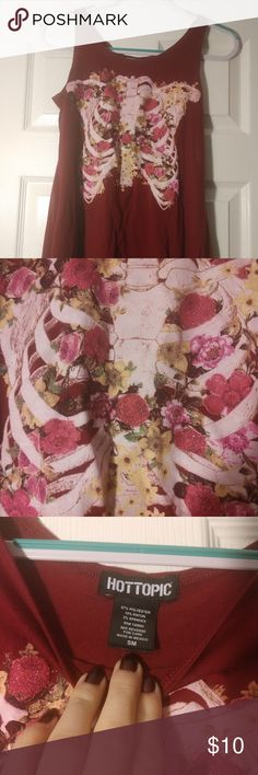 Flowers and Skeleton Ribs tank top EUC flower tank top with skeleton ribs. Sounds creepy but it's adorable! Ribs have a small amount of glitter in them along with the flowers. Hot Topic Tops Tank Tops