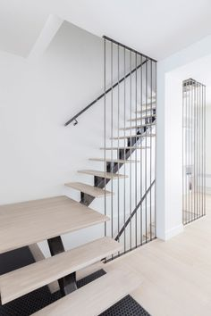 Kl.tz Design Renovates Light Filled Family Residence With Floating Staircase  In Montreal