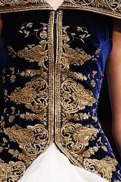 Alexander McQueen embroidery detail evokes an 18thC gentleman's embroidered waistcoat. Gorgeous!