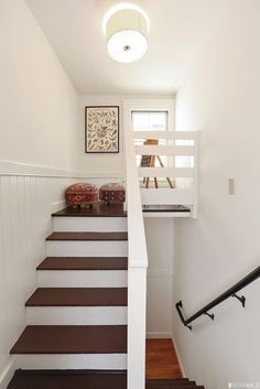 car sez: Add a door (or paint one if you are that good) matching the other rooms (oak) to the loft wall right side. The faux effect will do wonders to this charming, but ackward space.