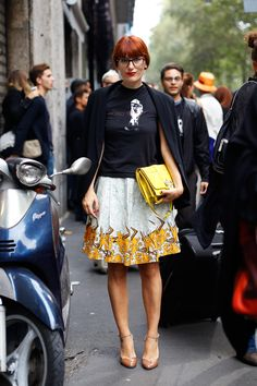 I love the mix of a feminine skirt and a screened tee. My summer uniform.