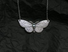 Moth Necklace is made of sterling silver and copper in sawing, etching and soldering techniques. Its entirely handmade. All patterns are designed and