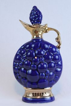 Jim Beam Whiskey Bottle Decanter Tulips Blue Gold 175 Months Regal China in box. Decanter is in excellent, empty condition. Whiskey Decanter, Whiskey Bottle, Liquor Bottles, Perfume Bottles, Jim Beam, Blue Gold, Whisky, Beams, Christmas Bulbs