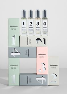 Custommade fragrance packaging. Create your own scent. 4 combinable fragrances. Art direction, packaging and bottle design by Homework. Photography by Oliver Knauer © custommade.dk