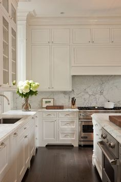 classic white kitchen with wide plank floors