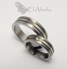 https://flic.kr/p/wgJeK7 | 888. Argollas de matrimonio en titanio, con doble canal amarillo y diamante. | www.elaliadojoyas.com info@elaliadojoyas.com Cel. 3203066543 - 3105753129 - 3002859190 Bogotá - Colombia