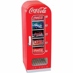 small, Coca-Cola-branded beverage refrigerator is perfect to keep drinks chilled and ready to drink in your family room, man cave, or even office. The Coca-Cola Vending Fridge holds 10 … Small Mini Fridge, Man Cave Mini Fridge, Mini Fridge In Bedroom, Deco Cinema, Movie Theater Rooms, Theatre Rooms, Movie Rooms, Beverage Refrigerator, Compact Refrigerator