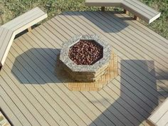 Close up view of this Fort Worth composite deck and the unique fire pit integrated into the decks design. - Outdoor Fireplaces and Firepits Photo Gallery - Archadeck of Fort Worth