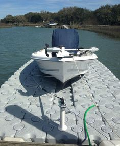 Dock Blocks are great for any boat. Pictured is a sea pro sitting up on our high-density polyethylene plastic drive-on boat lift. Our docks are easy to clean and do not flex when walked on #Boating