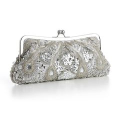 """Our lavish 10"""" w x 4 1/2"""" h satin evening bag boasts iridescent gold bugle beads, seed beads, sequins & purple gems. Our dressy beaded clutch purse has a silver frame & kiss clasp with detachable silv"""