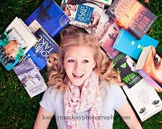 Picture of a senior girl as a book lover feel. Image by: katelynmckayphotography-blogspot.com
