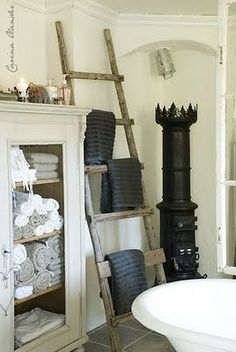 A gorgeous Norwegian stove for the bathroom, and a ladder one could easily build oneself.