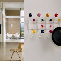 Order your Eames Hang-It-All. An original design by Charles and Ray Eames, this hanging rack is manufactured by Herman Miller.