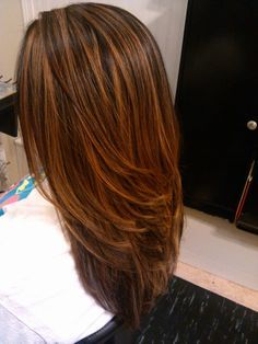 Love this color. It's a mixture of copper, brown, and possibly some golden highlights. Looks really natural and beautiful. Color, Low LIghts, Cut. Hair by: Nellie O | Yelp