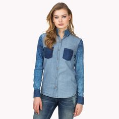 Denim shirt with eye-catching, Ikat-inspired patterns on the sleeves and collar.
