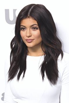 Kylie Jenner Wavy Dark Brown Loose Waves Hairstyle | Steal Her Style