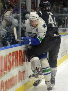 Tina Russell / Observer-Dispatch From left, Utica Comets player Brandon DeFazio is pushed up against the glass by San Antonio Rampage player Shane O'Brien during AHL hockey at the Utica Memorial Auditorium Thursday, Jan. 1, 2015. Read more: http://www.uticaod.com/apps/pbcs.dll/gallery?Site=NY&Date=20150101&Category=PHOTOGALLERY&ArtNo=101009998&Ref=PH&taxoid=&refresh=true#ixzz3NdcRAzZP