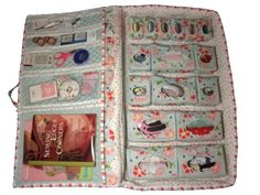 An amazing sew n go case - all made ITH and then sewn together. Comes in 2 sizes - one is large enough for your 24 inch ruler. Go to the site and check this out - clear vinyl inserts in little pouches on right side - so many incredible details!!  Also has shadow work designs and some beautiful Christmas stippling - a wonderful website.   My Fair lady designs.com.