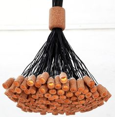 Cork Chandelier DO NOT KNOW HOW MUCH I LIKE, BUT INTERESTING. INSTED OF HANGING, I MIGHT DO WALL ORNAMENT LIGHTS COMBINING W/ WOOD…LET ME THINK