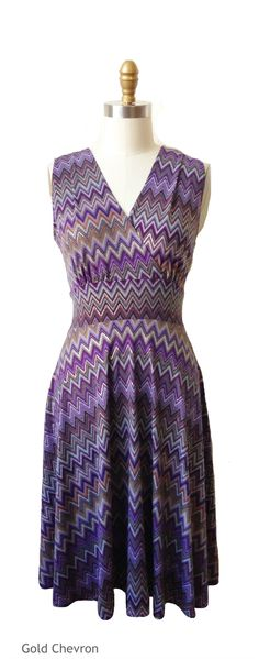$158.00 The Audrey Dress is a sleeveless dress for hourglass shapes. This purple and gold chevron dress is made in America and perfect for Fall! It's a v-neck, v-back, full swirl skirt that hits at your knees.