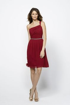 Watters 1524 Bridesmaid Dress.  This one-shoulder cocktail-length dress is fashioned in gorgeous crinkle chiffon. The ruched bodice has an inverted crisscrossed detail. It features an asymmetrical neckline, one narrow shoulder strap, and a semi-open back. The knee-length skirt has delicate pleats and flows in soft layered lines.