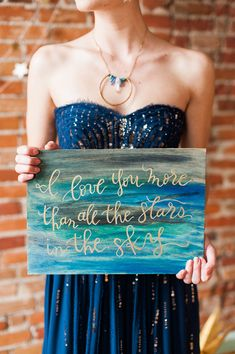 watercolor wedding sign - photo by Candice Benjamin Photography http://ruffledblog.com/galactic-wedding-with-a-navy-bridal-gown #calligraphy #weddingsigns