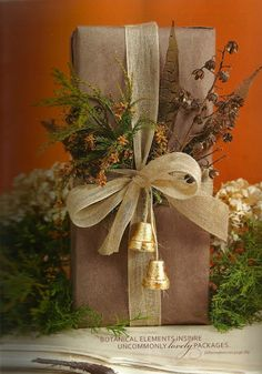 brown paper wrapping paper, gold ribbon, and dried floweers