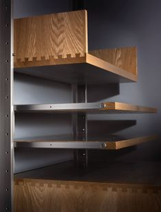 modular shelving system detail of dovetailed joints and solid hardwood display decks Bookshelf Storage, Modular Shelving, Shelving Systems, Shelving Ideas, Bookshelves, Modular Furniture, Handmade Furniture, Furniture Plans, Furniture Design