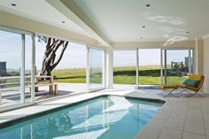 indoor pool with wrap around windows... Picture a deck around it. Mmm