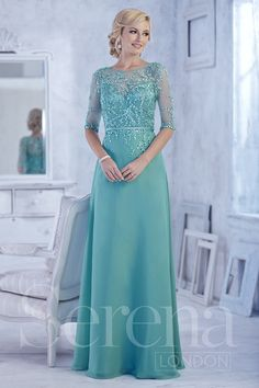Chiffon A-line gown with beaded appliques on high-neck bodice and 3/4-length sleeves. Thin satin band at waist.