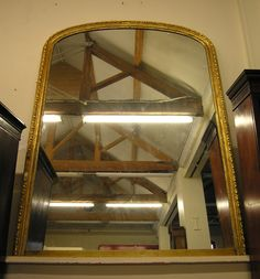 Antique 19th Century Gilt Gesso on Wood Over Mantle Wall Mirror of large proportions with a heavy thick plate glass from www.hutchisonantiques.com