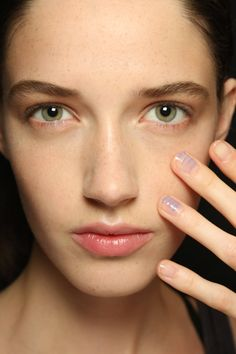 2015 nail art trend. nude or bare nails with a few purple or orange stripes. simple and clean looking.