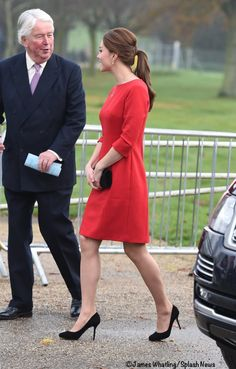 Kate in a pretty red Katherine Hooker dress (and ponytail!) for an EACH Engagement