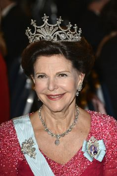 Queen Silvia of Sweden wears The Nine Prong diamond Tiara as she attends the Nobel Prize Banquet 2013 at City Hall in Stockholm, Sweden.