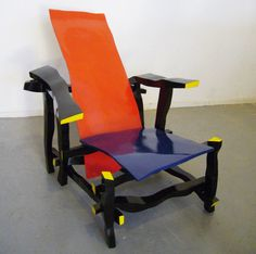 """""""The Left-handed Rietveld Chair is based on right-handed Berthier's southpaw drawings of Gerrit Rietveld's Red and Blue Chair, one of the most widely recognized artifacts of the de Stijl movement. Berthier, a French designer, then gave his drawings to a carpenter, who built five identical chairs to spec."""" Caption from link"""